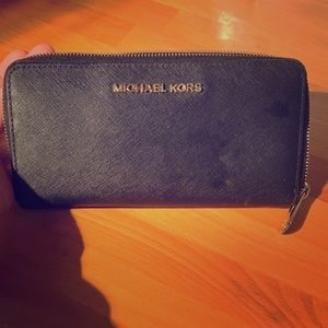 Black leather Michael Kors wallet with gold zipper